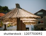 reed sunshade pattern beside... | Shutterstock . vector #1207703092