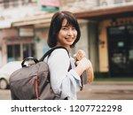 attractive asian woman travel... | Shutterstock . vector #1207722298