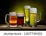 cool beer mugs on a wooden... | Shutterstock . vector #1207739302