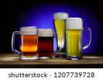 cool beer mugs on a wooden... | Shutterstock . vector #1207739728