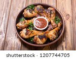 grilled chicken legs with...   Shutterstock . vector #1207744705