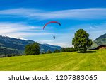 a paraglider wants to land in a ... | Shutterstock . vector #1207883065