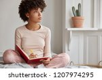 cropped shot of dark skinned... | Shutterstock . vector #1207974295