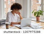 dark skinned female specialist... | Shutterstock . vector #1207975288