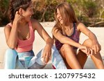 relaxed happy young mixed race... | Shutterstock . vector #1207975432