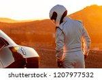 a helmet wearing race car... | Shutterstock . vector #1207977532