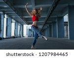 ballerina dancing in jeans  t... | Shutterstock . vector #1207984465