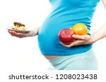 woman in pregnant holding fresh ... | Shutterstock . vector #1208023438