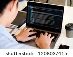 a male programer working with... | Shutterstock . vector #1208037415