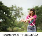 young woman golfer playing golf | Shutterstock . vector #1208039065
