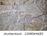 a background of a wall of large ... | Shutterstock . vector #1208064685