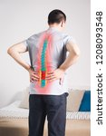pain in the spine  a man with... | Shutterstock . vector #1208093548