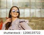 happy brunette woman with... | Shutterstock . vector #1208135722