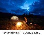 active woman traveller having a ... | Shutterstock . vector #1208215252