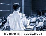 speaker giving a talk on... | Shutterstock . vector #1208229895