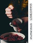 female hands pouring ripe... | Shutterstock . vector #1208235955