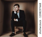 young businessman in black suit ...   Shutterstock . vector #1208237668