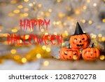 three spooky orange pumpkins.... | Shutterstock . vector #1208270278