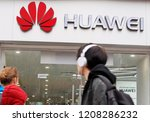 people walk past of a huawei... | Shutterstock . vector #1208286232