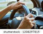women's hands on the wheel | Shutterstock . vector #1208297815