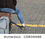 Woman Sitting On A Suitcase...