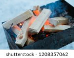 in the winter on a brazier... | Shutterstock . vector #1208357062