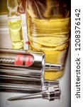 vintage glass syringe and... | Shutterstock . vector #1208376142
