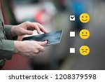 Businessman holding a smart tablet, mobile cell, in traffic daytime, cars in the background. with a checked box on Excellent Smiley Face Rating for a Satisfaction Survey, Customer Experience Concept