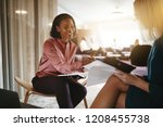 smiling young businesswoman... | Shutterstock . vector #1208455738