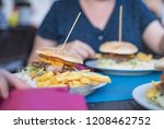 big burger with fries and salad | Shutterstock . vector #1208462752