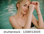 pretty young blonde woman...   Shutterstock . vector #1208513035
