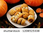 scary sausage mummies in dough... | Shutterstock . vector #1208525338