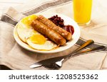 grilled sausages with sauce... | Shutterstock . vector #1208525362