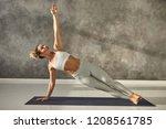 pretty girl wearing leggings... | Shutterstock . vector #1208561785