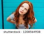 thoughtful attractive redhead... | Shutterstock . vector #1208564938