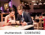 smiling couple reading menu ... | Shutterstock . vector #120856582