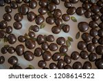 chocolate dragee filled with... | Shutterstock . vector #1208614522