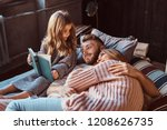 mom  dad and daughter reading... | Shutterstock . vector #1208626735