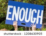 Stock photo a protester holds sign enough at the march for our lives rally 1208630905
