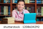 cute schoolboy using computer... | Shutterstock . vector #1208634292