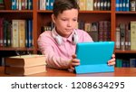 cute schoolboy using computer... | Shutterstock . vector #1208634295