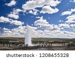 Strokkur Eruption With Tourists