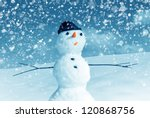 Snow Man In Santa Cap On Natur...