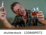 young messy and wasted addict... | Shutterstock . vector #1208689072