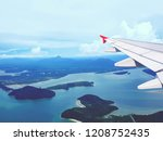 airplane wing in blue sky lots... | Shutterstock . vector #1208752435