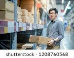 asian shopper man standing...   Shutterstock . vector #1208760568