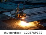 the cutting machine is cutting... | Shutterstock . vector #1208769172