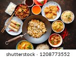 Stock photo asian food set noodles fried rice with chicken tom yum soup spring rolls deep fried fish and 1208773552
