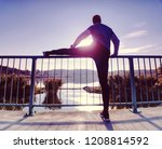 man stretching legs before... | Shutterstock . vector #1208814592