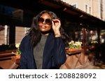 stylish african american girl... | Shutterstock . vector #1208828092